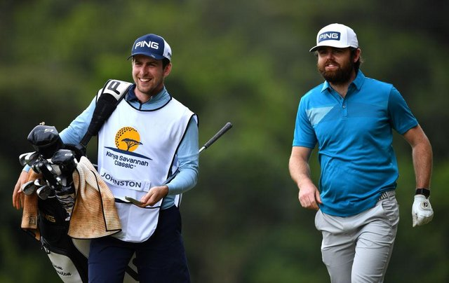 Liam Johnston walks with his caddie on the 15th hole during the opening round of the Kenya Savannah Classic at Karen Country Club in Nairobi. Picture: Stuart Franklin/Getty Images.