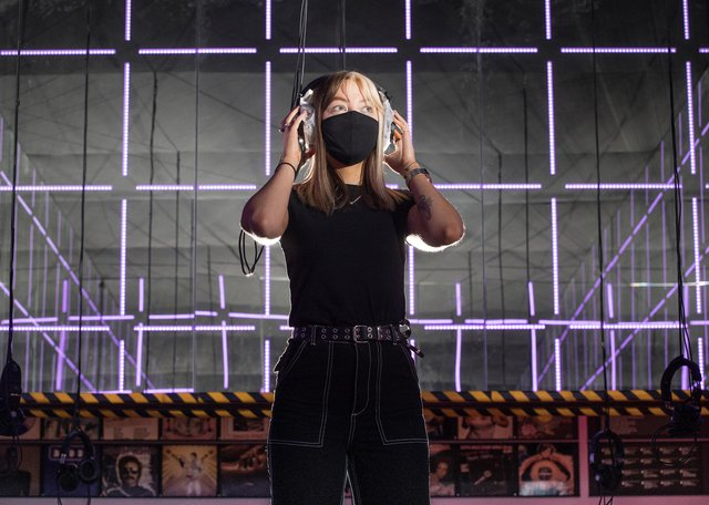 Visitor assistant Lucy Hendry in Night Fever's 'socially distanced silent disco.' Picture: Michael McGurk