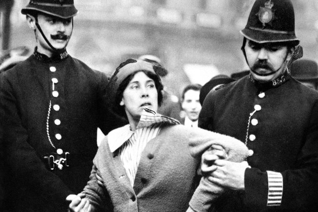 A suffragette is arrested by police officers in 1914. The Representation of the People Act, passed in 1918, gave certain women over the age of 30 a vote and the right to stand for Parliament. (Picture: PA)