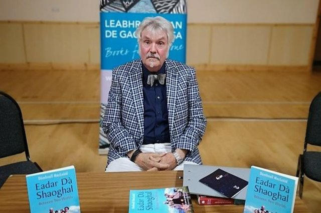 Donald Ian MacLeod at a signing session for his award-winning book Eadar Da Shaoghal