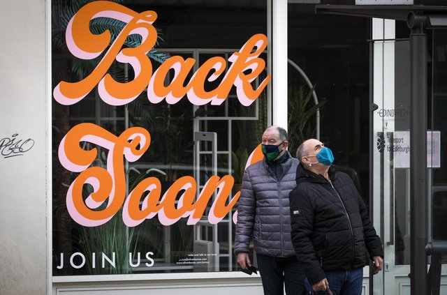 """Sign that reads """"Back Soon"""" in the window of a closed shop in Edinburgh city centre, as lockdown measures for mainland Scotland continue picture: PA/Jane Barlow"""