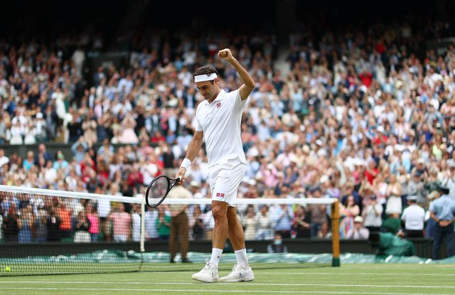 Roger Federer celebrates his Centre Court victory over Cameron Norrie