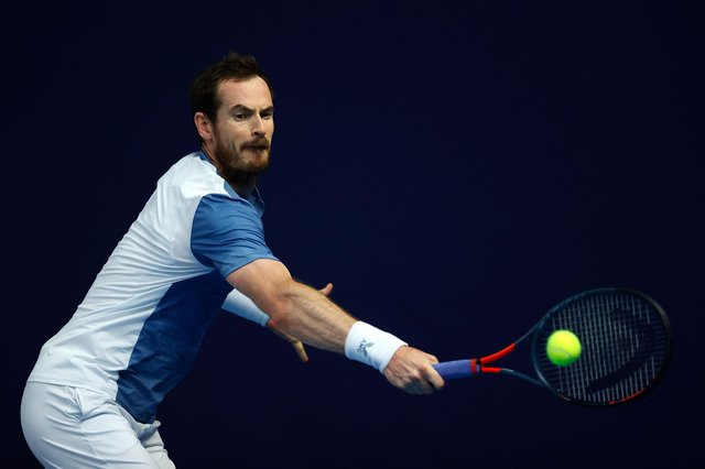 Andy Murray plays a backhand against Kyle Edmund at the Schroders Battle of the Brits event at Roehampton.