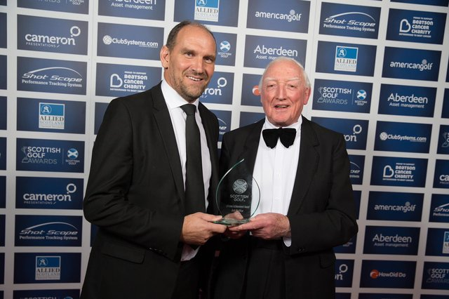 Martin Dempster, The Scotsman's golf correspondent, presents Jock MacVicar with a lifetime achievemet accolade at the Scottish Golf Awards in Edinburgh in 2017. Picture: Kenny Smith