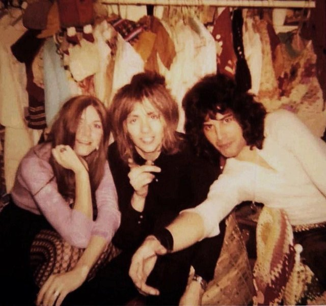 Freddie Mercury (right), Roger Taylor (centre), and Mary Austin in Alan Mair's stall at Kensington Market in 1970.