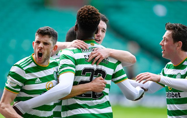 Celtic's Mohamed Elyounoussi celebrates making it 1-0 with his teammates during the Scottish Premiership match against Rangers at Celtic Park. (Photo by Rob Casey / SNS Group)