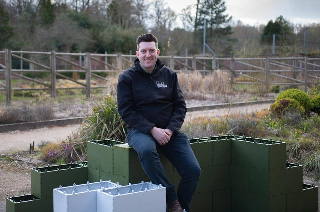 Andrew Vincent with the building blocks, which are made from recycled plastic. Picture: Andrew Loughlin, 360 Bid