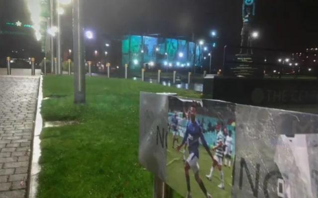A poster of Connor Goldson celebrating put up near Celtic Park.