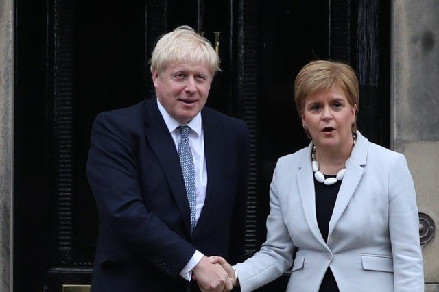 Both Boris Johnson and Nicola Sturgeon said they would be led by 'data, not dates' as they set out tentative plans to ease the Covid lockdown (Picture: Jane Barlow/PA Wire)