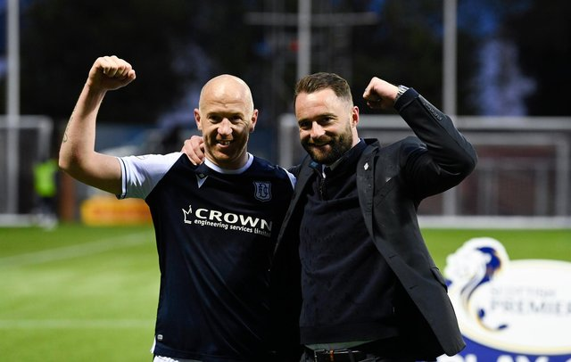 Dundee's Charlie Adam and manager James McPake celebrate at full time at Rugby Park.