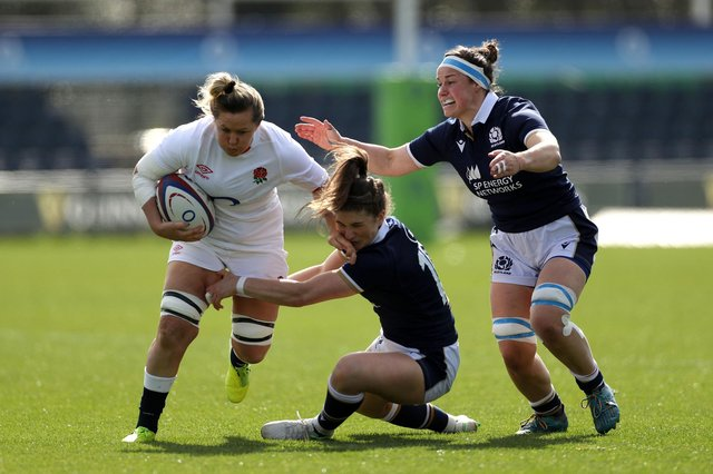 England's Marlie Packer attempts to brush off the tackle from Scotland's Helen Nelson (centre) and Rachel Malcolm (right) during the Women's Six Nations match at Castle Park, Doncaster. Picture: Bradley Collyer/PA