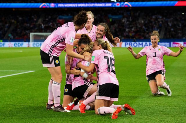 19/06/19 2019 FIFA WOMEN'S WORLD CUP: GROUP D SCOTLAND v ARGENTINA  PARC DE PRINCES - PARIS Erin Cuthbert is mobbed by her teammates after making it 3-0 to Scotland.
