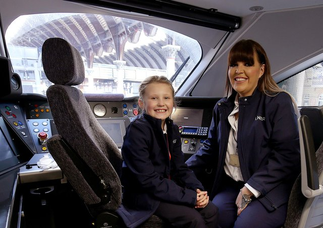 LNER driver Becky Brown and her daughter Maisie in a train cab. PIcture: Nigel Roddis/PA Wire