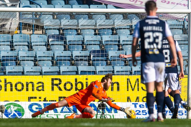 Dundee skipper Charlie Adam's penalty has been tipped onto the post by St Johnstone 'keeper Zander Clark with the ball about to return to the keeper's arms (Photo by Craig Foy / SNS Group)