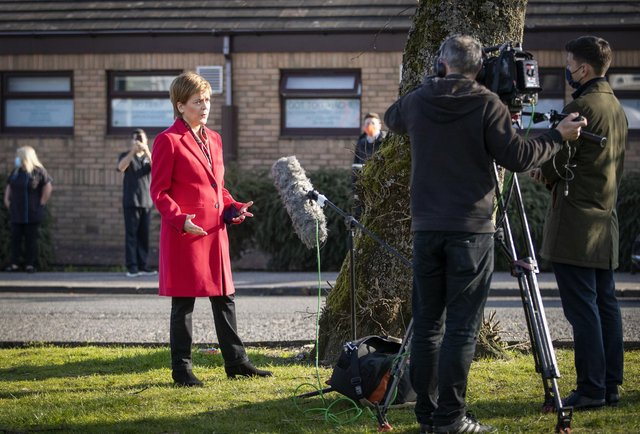 Scotland's First Minister Nicola Sturgeon speaks to the media during a visit to the Thornliebank Dental Care centre in Glasgow during the election campaign.