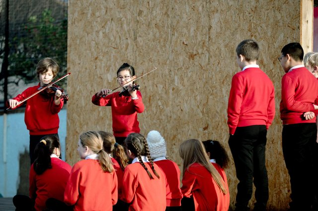 Harris Hawkey and Luo Lin Zheng perform for pupils at Hermitage Park Primary School in Leith today to launch the new initiative. Picture: Ryan Buchanan