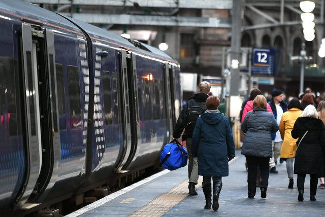 Ticket examiners operate on most trains in and around Glasgow. Picture: John Devlin