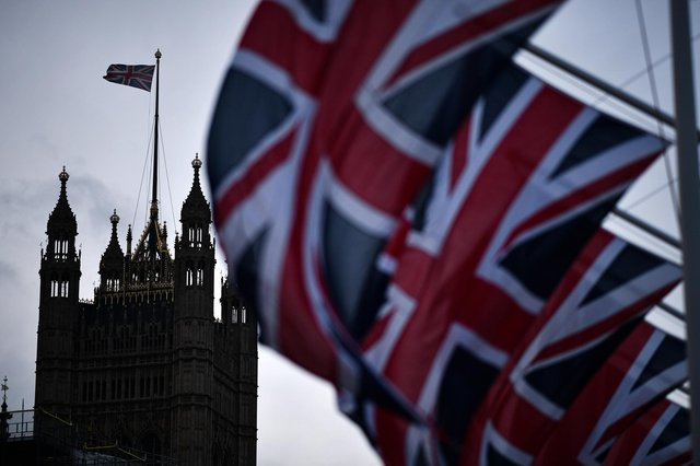Union Jack flags hang in parliament square to mark Britain's exit from the EU (Photo by Jeff J Mitchell/Getty Images)