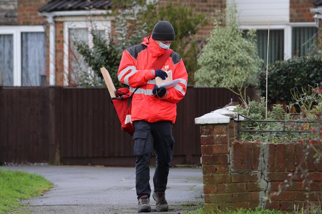 A Royal Mail delivery worker.