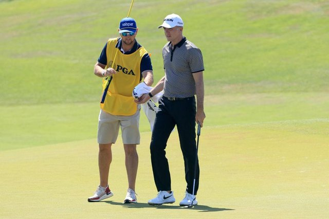 Martin Laird is handed his ball by fellow Sco Kevin McAlpine as he prepares to putt on the 17th hole during the second round of the 2021 PGA Championship at Kiawah Island. Picture: Sam Greenwood/Getty Images.