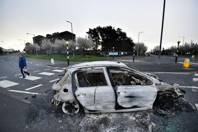 Burnt out cars can be seen at the Cloughfern roundabout junction following overnight Loyalist violence on April 4, 2021 in Belfast, Northern Ireland. Loyalist unrest and disorder in the province continues as a result of the implementation of the so called Irish sea border.