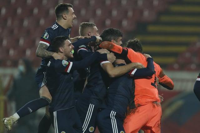 Scotland players celebrate their victory in the Euro 2020 playoff final soccer match between Serbia and Scotland, at the Rajko Mitic stadium in Belgrade, Serbia, Thursday, Nov. 12, 2020. (AP Photo/Darko Vojinovic)