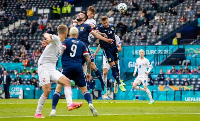 Czech Republic striker Patrik Schick rises above Scotland defender Grant Hanley to head home the first goal of the Group D opener at Hampden. (Photo by Craig Williamson / SNS Group)