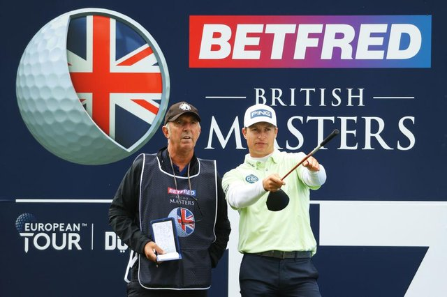 """Calum Hill picks a line with caddie Phil """"Wobbly"""" Morbey on the 17th hole during the first round of The Betfred British Masters hosted by Danny Willett at The Belfry. Picture: Andrew Redington/Getty Images."""
