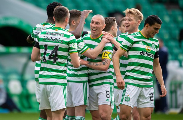 Scott Brown, centre, played his last match at Celtic Park as a Hoops player and set up Odsonne Edouard for their second goal against St Johnstone.