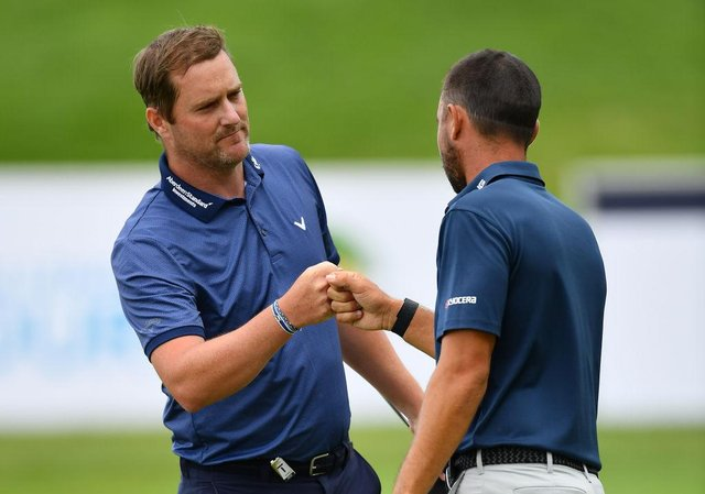 Marc Warren is congratulated by Spaniard Sebastian Garcia Rodriguez after winning the Austrian Open at Diamond Country Club last July. Picture: Stuart Franklin/Getty Images.