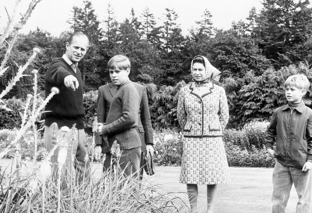 Queen Elizabeth II and the Duke of Edinburgh with sons Prince Andrew, left, and Prince Edward, at Balmoral to celebrate their Silver Wedding anniversary.