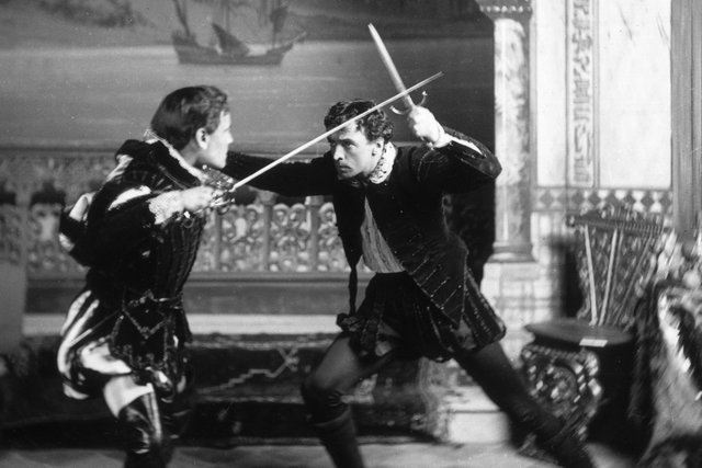 19th-century actors stage a fencing duel in Shakespearean costume. (Picture: Getty Images)