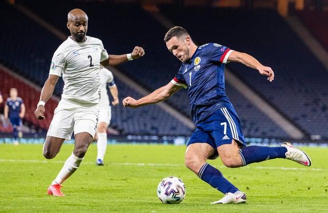 Scotland's John McGinn beats Israel's Eli Dasa to the ball during last month's play-off semi-final at Hampden Park (Photo by Craig Williamson / SNS Group)