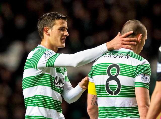 """Aleksandar Tonev claps Celtic captain Scott Brown, who says he """"stuck up"""" for the Bulgarian over his 2014 racial abuse of soon-to-be Aberdeen team-mate Shay Logan because Tonev """"swore he didn't do it"""". [Photo by Sammy Turner/SNS Group)."""