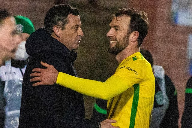 Jack Ross congratulates Christian Doidge after the Hibs striker scored twice against Queen of the South.