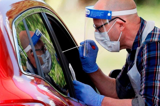 Only those with Covid-19 symptoms should arrange to have a test carried out (Photo: ADRIAN DENNIS/AFP via Getty Images)