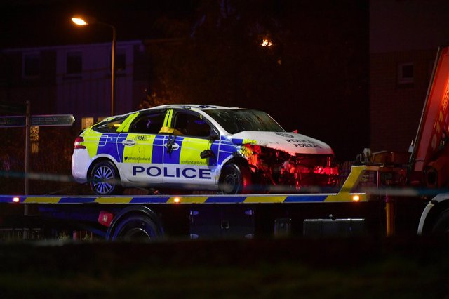 The police car looks badly smashed up after the collision.