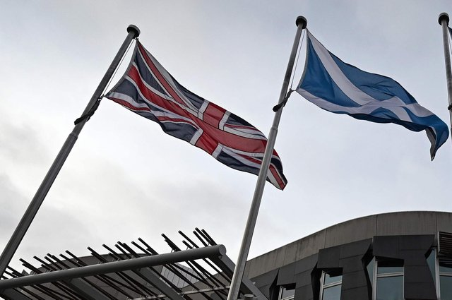 Scottish independence and unionism are often represented by the Saltire and the Union Jack, but there is a third choice: Home Rule (Picture: Andy Buchanan/AFP via Getty Images)