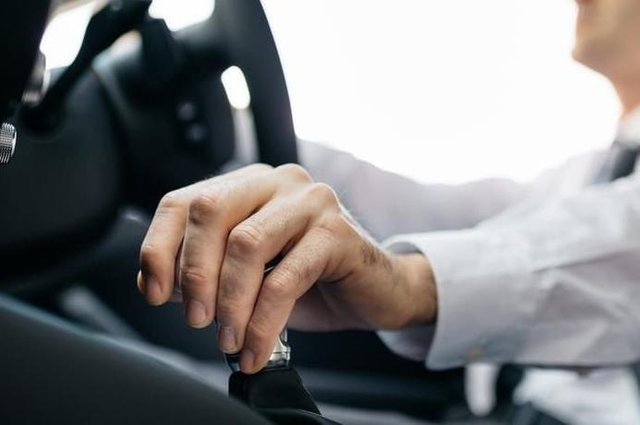 Stock image of man driving a car.
