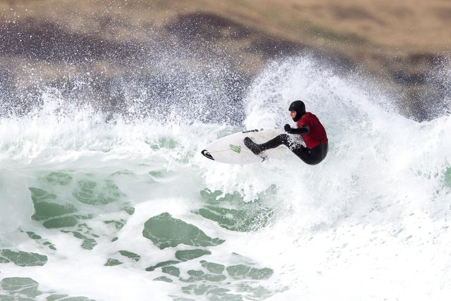 England's Stan Norman on his way to winning the men's division on day two of the British Surfing Championships at Thurso East. PIC: Jane Barlow/PA Wire.