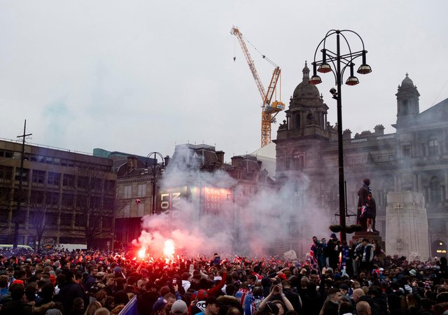 Rangers fans celebrating their title win in George Square in March. Picture: SNS