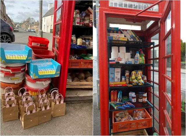 A red telephone box has been transformed into a 'community larde