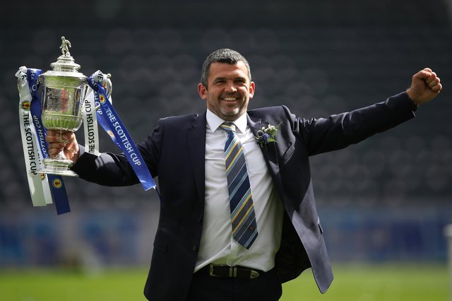 St Johnstone manager Callum Davidson celebrates with the Scottish Cup after his team's 1-0 win over Hibernian in the final at Hampden. (Photo by Ian MacNicol/Getty Images)