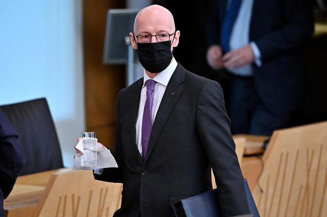 Deputy First Minister John Swinney has been accused of secrecy around the failure to publish a report into Scottish education.