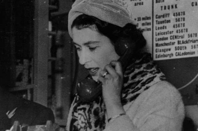 The Queen speaks on a telephone at the Bristol exchange making Britain's first subscriber trunk dialled telephone call to Edinburgh in 1958.
