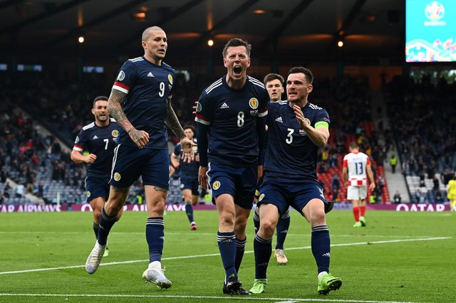 Callum McGregor celebrates with teammates Lyndon Dykes and Andrew Robertson after scoring Scotland's first goal during the Euro 2020 Championship Group D match between Croatia and Scotland (Getty Images)