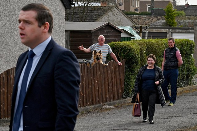 Members of the public watch the Scottish Conservative leader Douglas Ross as he pays a visit to the former Loanhead police station. (Photo by Jeff J Mitchell/Getty Images)