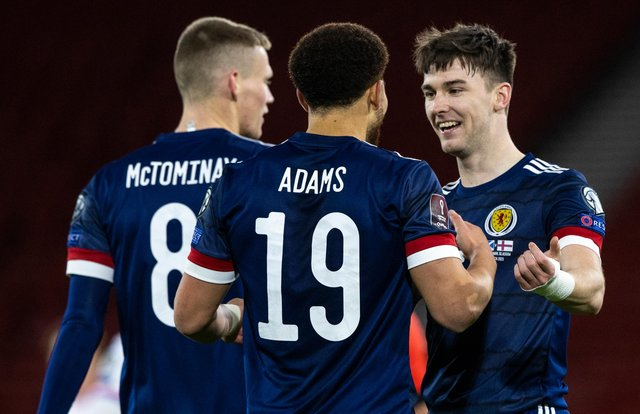 Che Adams, centre, scored his first goal for Scotland while Kieran Tierney, right, put in an excellent performance.