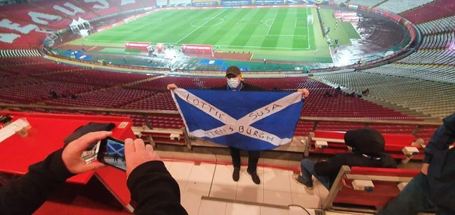 Gordon was the sole Scottish fan to witness th national team beat Serbia to make the Euro 2020 finals