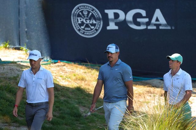 Justin Thomas, Brooks Koepka and Rory McIlroy walk to the 17th green during the first round of the 2021 PGA Championship at Kiawah Island Resort's Ocean Course in Kiawah Island, South Carolina. Picture: Stacy Revere/Getty Images.